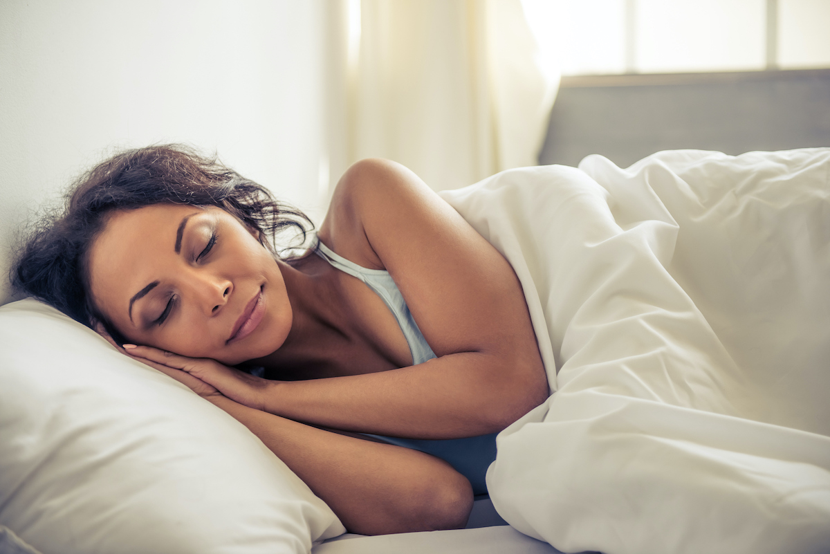 beautiful BIPOC woman sleeping