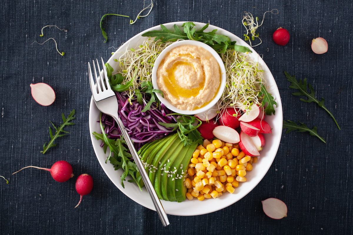 plate of vegetables with hummus