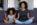 BIPOC mother and daughter meditating together