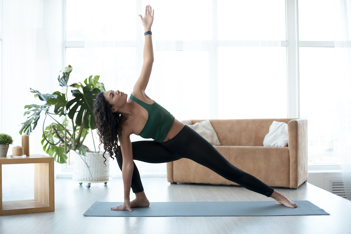 woman doing yoga from home