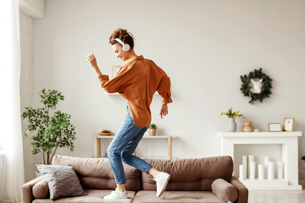 moving meditation. Happy young woman dances in her living room.