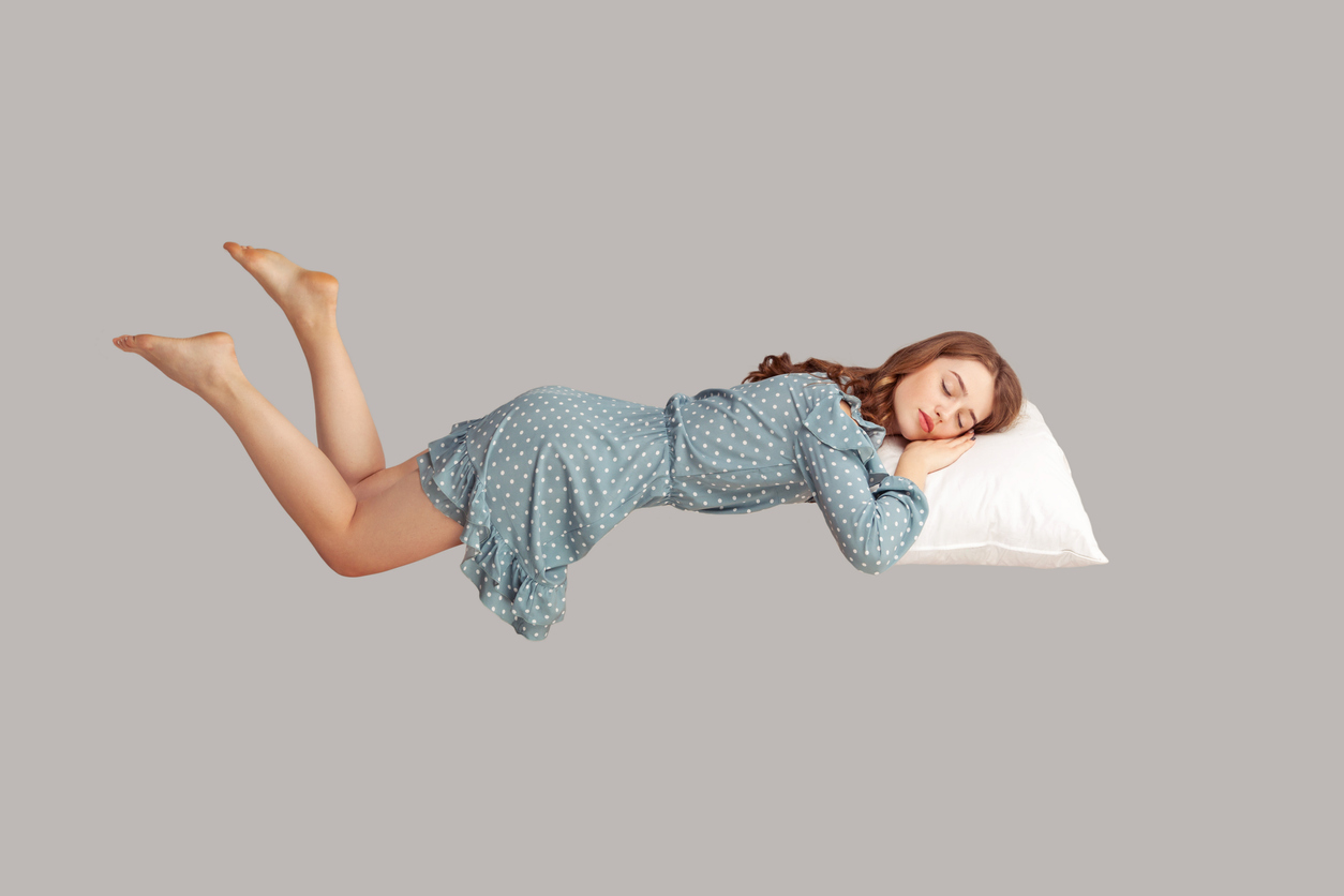 Pretty young woman sleeping on pillow in vintage dress
